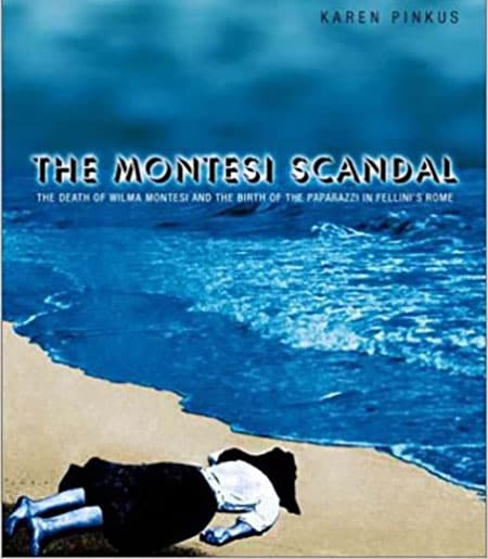 Scandal-related image of woman face down on the beach with bright blue ocean.